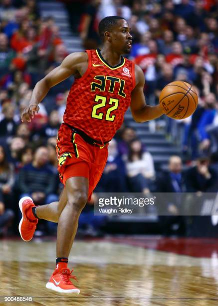 Isaiah Taylor of the Atlanta Hawks dribbles the ball during the second half of an NBA game against the Toronto Raptors at Air Canada Centre on...