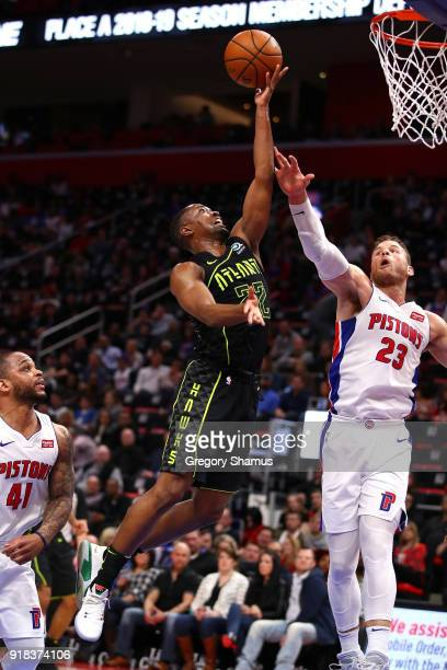Isaiah Taylor of the Atlanta Hawks gets a shot off past Blake Griffin of the Detroit Pistons during the second half at Little Caesars Arena on...