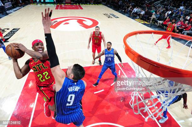 Isaiah Taylor of the Atlanta Hawks goes to the basket against the Orlando Magic on December 9 2017 at Philips Arena in Atlanta Georgia NOTE TO USER...