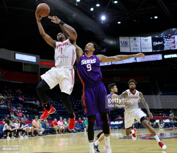 Isaiah Taylor of the Rio Grande Valley Vipers is fouled by Chris McCullough of the Northern Arizona Suns at the State Farm Arena March 19 2017 in...