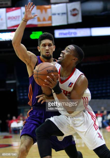 Isaiah Taylor of the Rio Grande Valley Vipers works the ball around Askia Booker of the Northern Arizona Suns at the State Farm Arena March 19 2017...
