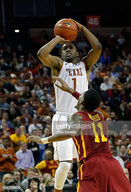 Isaiah Taylor of the Texas Longhorns shoots over Monte Morris of the Iowa State Cyclones at the Frank Erwin Center on January 12 2016 in Austin Texas