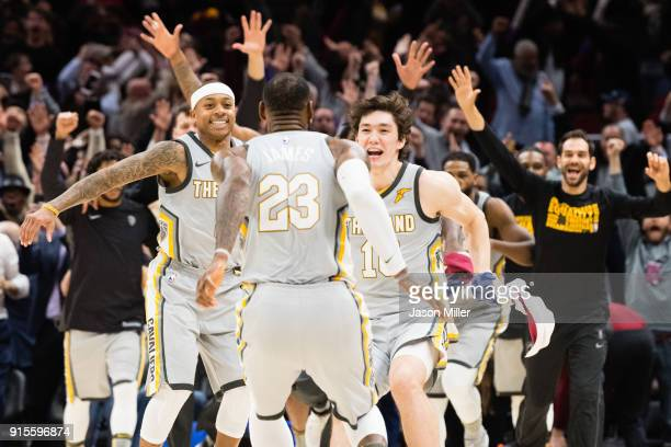 Isaiah Thomas and Cedi Osman celebrate with LeBron James of the Cleveland Cavaliers after James scored the game winning point during last second of...