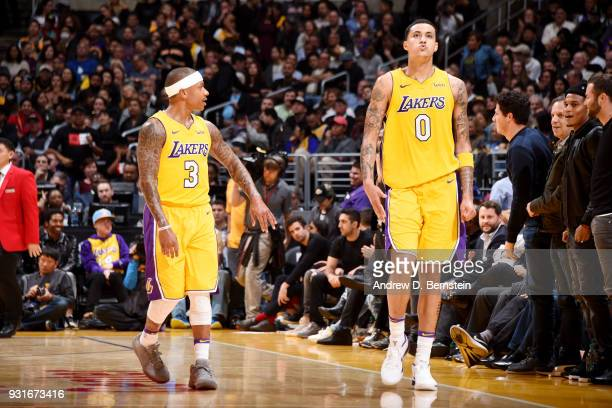 Isaiah Thomas and Kyle Kuzma of the Los Angeles Lakers look on during the game against the Denver Nuggets on March 13 2018 at STAPLES Center in Los...