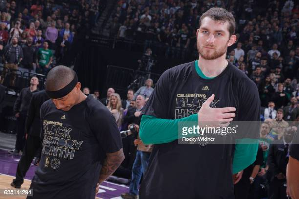 Isaiah Thomas and Tyler Zeller of the Boston Celtics stand during the national anthem of the game against the Sacramento Kings on February 8 2017 at...