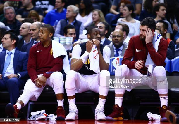 Isaiah Thomas Dwyane Wade and Kevin Love of the Cleveland Cavaliers look on from the bench during the second half of an NBA game against the Toronto...