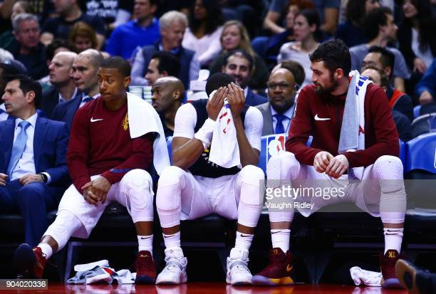 Isaiah Thomas Dwayne Wade and Kevin Love of the Cleveland Cavaliers look on from the bench during the second half of an NBA game against the Toronto...