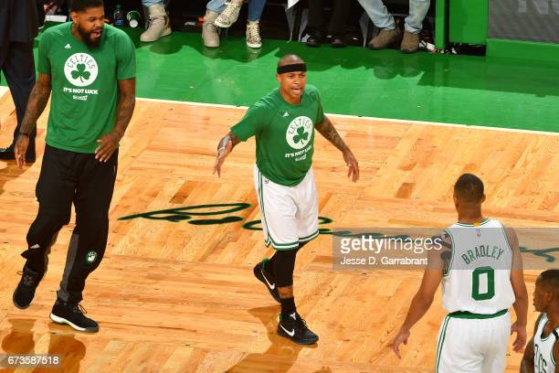 Isaiah Thomas goes to high five Avery Bradley of the Boston Celtics during the game against the Chicago Bulls in Game Five of the Eastern Conference...