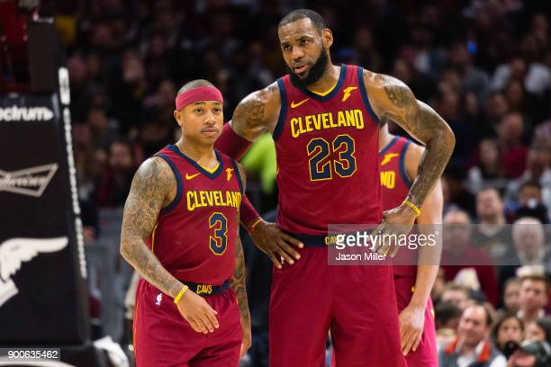 Isaiah Thomas listens to LeBron James of the Cleveland Cavaliers during the first half against the Portland Trail Blazers at Quicken Loans Arena on...