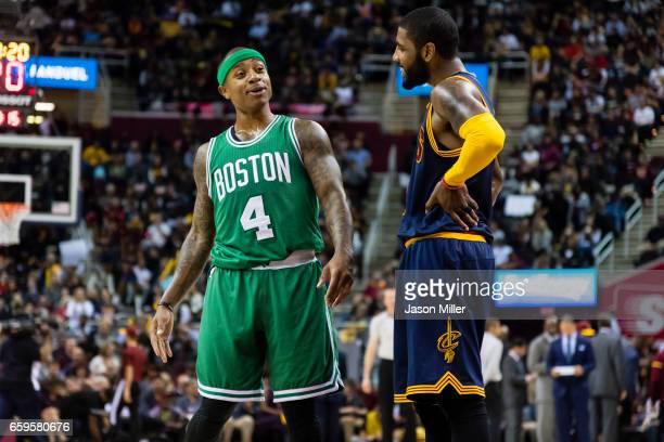 Isaiah Thomas of the Boston Celtics and Kyrie Irving of the Cleveland Cavaliers talk on the court during the first half at Quicken Loans Arena on...