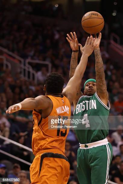 Isaiah Thomas of the Boston Celtics attemtps a shot over Alan Williams of the Phoenix Suns during the second half of the NBA game at Talking Stick...