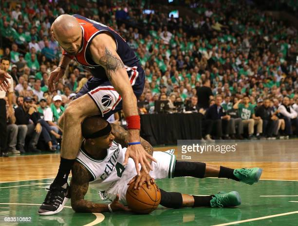 Isaiah Thomas of the Boston Celtics battles for the ball under Marcin Gortat of the Washington Wizards during Game Seven of the NBA Eastern...