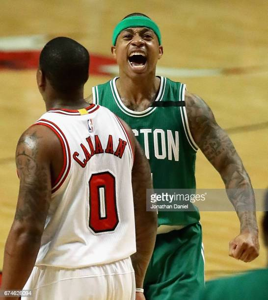 Isaiah Thomas of the Boston Celtics celebrates after an assist that lead to a dunk as Isaiah Canaan of the Chicago Bulls walks to the bench during...