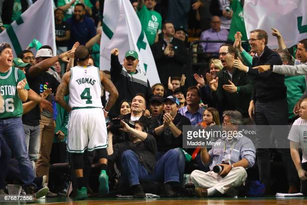 Isaiah Thomas of the Boston Celtics celebrates with fans after hitting a three point shot during the fourth quarter of Game Two of the Eastern...