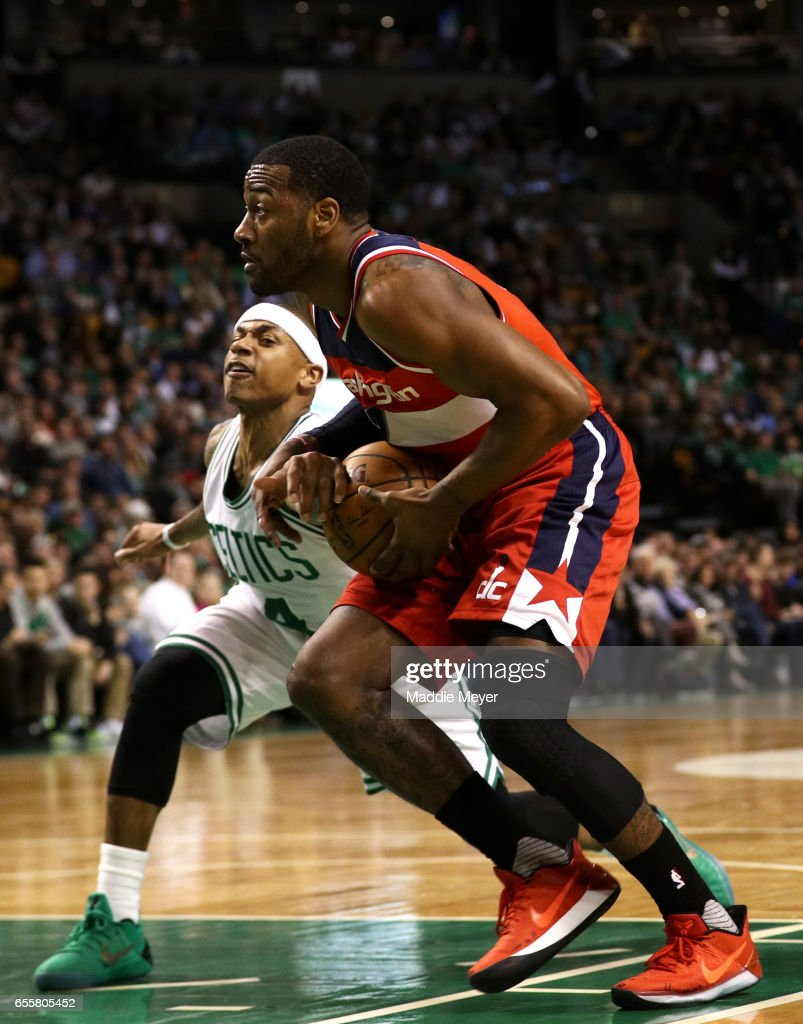 Isaiah Thomas #4 of the Boston Celtics defends John Wall #2 of the Washington Wizards during the second quarter at TD Garden on March 20, 2017 in Boston, Massachusetts.