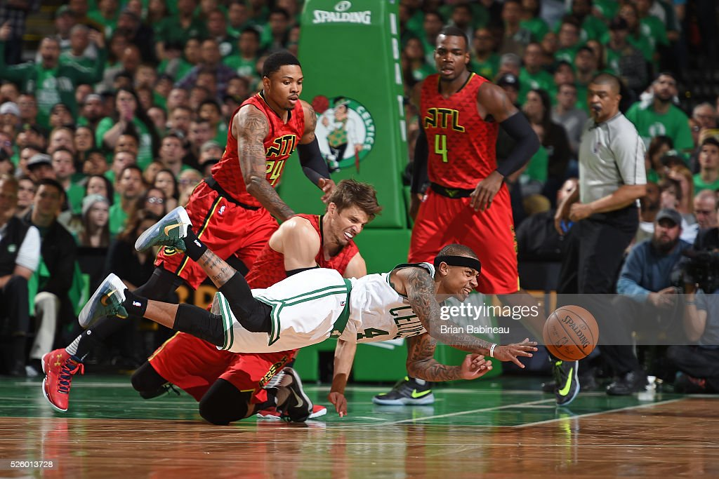 Isaiah Thomas #4 of the Boston Celtics dives and passes the ball while guarded by Kyle Korver #26 of the Atlanta Hawks in Game Six of the Eastern Conference Quarterfinals during the 2016 NBA Playoffs on April 28, 2016 at TD Garden in Boston, Massachusetts.