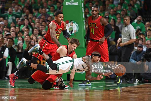 Isaiah Thomas of the Boston Celtics dives and passes the ball while guarded by Kyle Korver of the Atlanta Hawks in Game Six of the Eastern Conference...