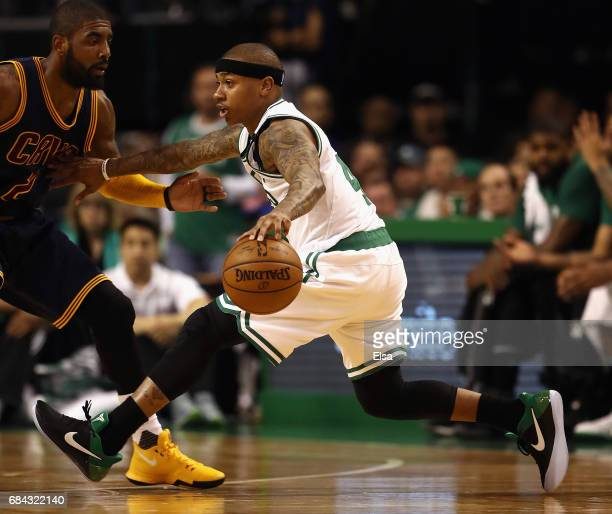 Isaiah Thomas of the Boston Celtics dribbles against Kyrie Irving of the Cleveland Cavaliers in the first half during Game One of the 2017 NBA...