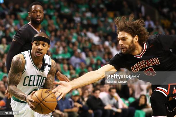 Isaiah Thomas of the Boston Celtics dribbles past Robin Lopez of the Chicago Bulls during the third quarter of Game Two of the Eastern Conference...