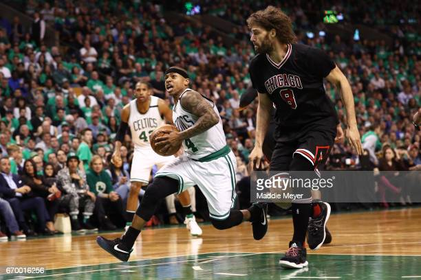 Isaiah Thomas of the Boston Celtics drives against Robin Lopez of the Chicago Bulls during the third quarter of Game Two of the Eastern Conference...
