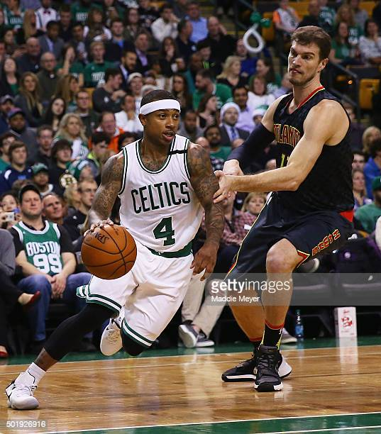Isaiah Thomas of the Boston Celtics drives against Tiago Splitter of the Atlanta Hawks during the second quarter at TD Garden on December 18 2015 in...