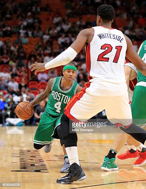 Isaiah Thomas of the Boston Celtics drives on Hassan Whiteside of the Miami Heat during a game at American Airlines Arena on November 28 2016 in...