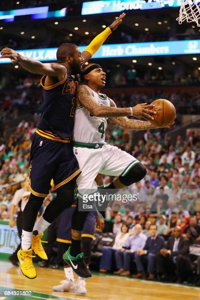 Isaiah Thomas of the Boston Celtics drives to the basket against Kyrie Irving of the Cleveland Cavaliers in the second half during Game One of the...