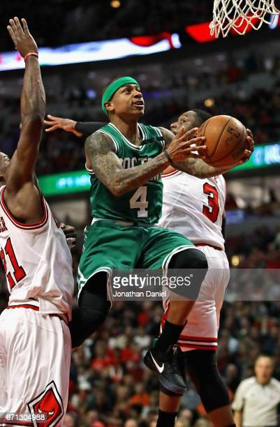 Isaiah Thomas of the Boston Celtics drives to the basket between Jimmy Butler and Dwyane Wade of the Chicago Bulls during Game Three of the Eastern...