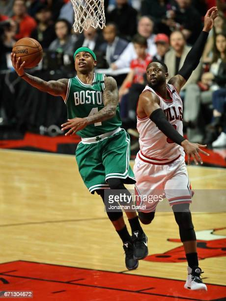 Isaiah Thomas of the Boston Celtics drives to the basket past Dwyane Wade of the Chicago Bulls during Game Three of the Eastern Conference...