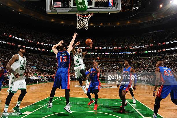 Isaiah Thomas of the Boston Celtics goes for the layup against Aron Baynes of the Detroit Pistons during the game on January 6 2016 at TD Garden in...
