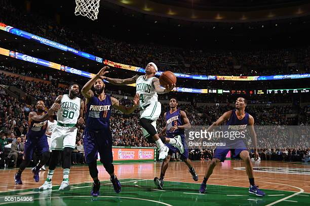 Isaiah Thomas of the Boston Celtics goes to the basket against the Phoenix Suns on January 15 2016 at the TD Garden in Boston Massachusetts NOTE TO...