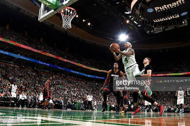 Isaiah Thomas of the Boston Celtics goes to the basket during the game against the Miami Heat on December 30 2016 at the TD Garden in Boston...
