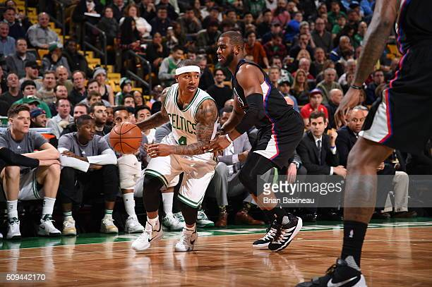 Isaiah Thomas of the Boston Celtics handles the ball against Chris Paul of the Los Angeles Clippers on February 10 2016 at the TD Garden in Boston...