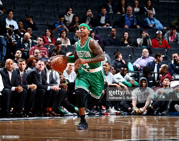 Isaiah Thomas of the Boston Celtics handles the ball during a preseason game against the Brooklyn Nets on October 13 2016 at Barclays Center in...