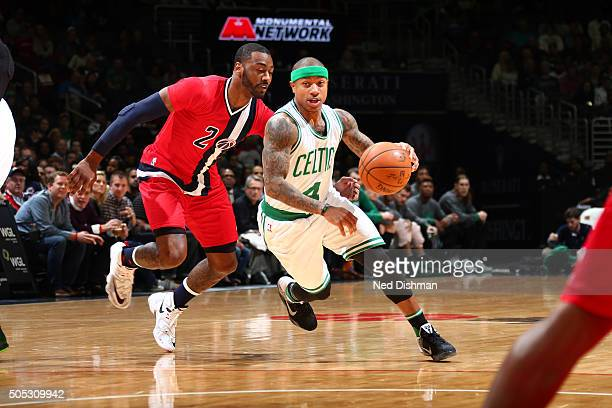 Isaiah Thomas of the Boston Celtics handles the ball during the game against the Washington Wizards on January 16 2016 at Verizon Center in...