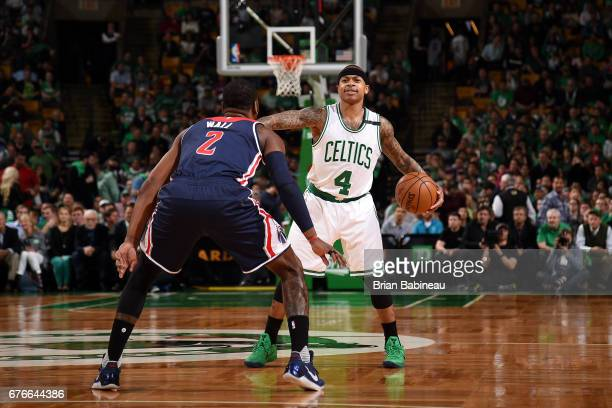 Isaiah Thomas of the Boston Celtics handles the ball during the game against John Wall of the Washington Wizards during Game Two of the Eastern...