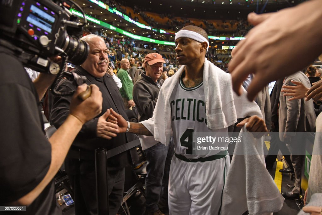 Isaiah Thomas #4 of the Boston Celtics high fives fans as he heads to the locker room after the game against the Cleveland Cavaliers on March 1, 2017 at the TD Garden in Boston, Massachusetts.