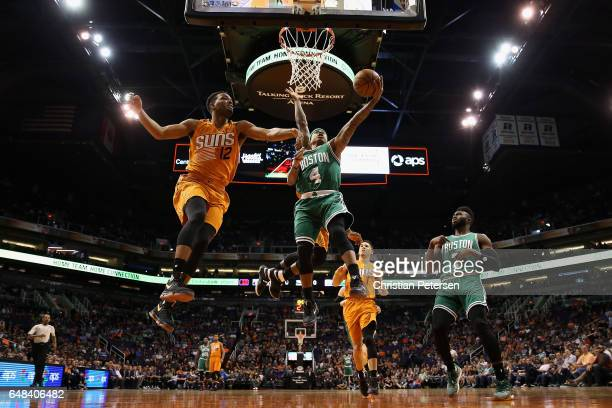 Isaiah Thomas of the Boston Celtics lays up a shot past TJ Warren of the Phoenix Suns during the first half of the NBA game at Talking Stick Resort...