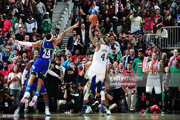 Isaiah Thomas of the Boston Celtics shoots the game winning shot against the Atlanta Hawks during the game on January 13 2017 at Philips Arena in...