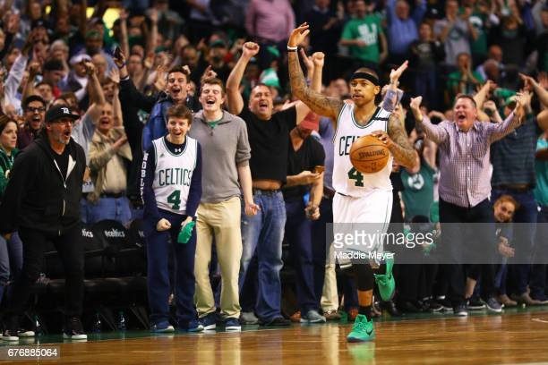 Isaiah Thomas of the Boston Celtics signals to the crowd during overtime of the Celtics 129119 win over the Washington Wizards in Game Two of the...