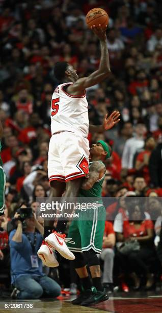 Isaiah Thomas of the Boston Celtics stands his ground as Bobby Portis of the Chicago Bulls is called for a charge while shooting during Game Four of...