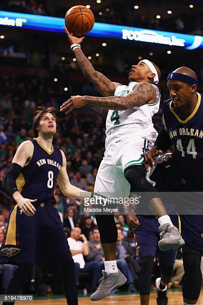 Isaiah Thomas of the Boston Celtics takes a shot against Dante Cunningham of the New Orleans Pelicans during the fourth quarter at TD Garden on April...
