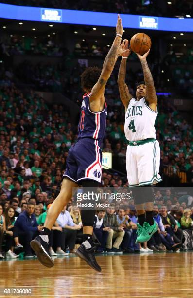Isaiah Thomas of the Boston Celtics takes a shot against Kelly Oubre Jr #12 of the Washington Wizards during the second half of Game Five of the...