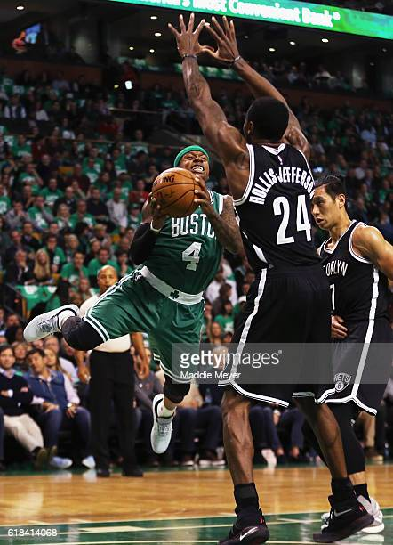 Isaiah Thomas of the Boston Celtics takes a shot against Rondae HollisJefferson of the Brooklyn Nets during the first quarter at TD Garden on October...