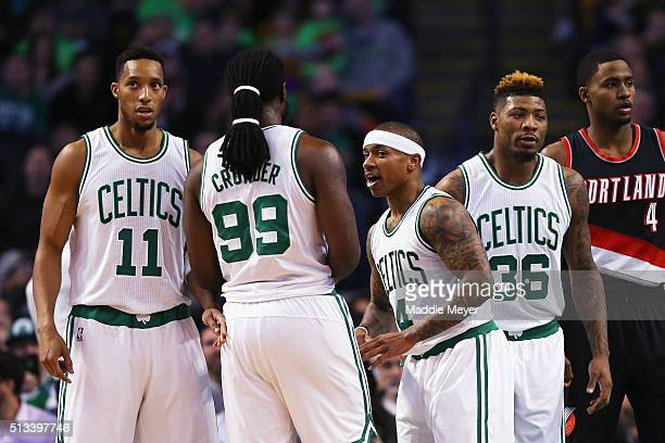 Isaiah Thomas of the Boston Celtics talks with Jae Crowder Marcus Smart and Evan Turner during the first quarter against the Portland Trail Blazers...