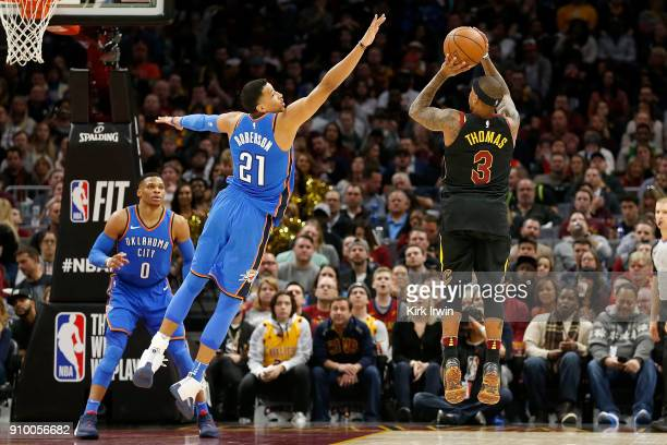 Isaiah Thomas of the Cleveland Cavaliers attempts to shoot the ball over the defense of Andre Roberson of the Oklahoma City Thunder during the game...