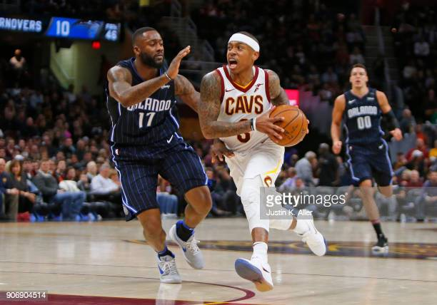 Isaiah Thomas of the Cleveland Cavaliers carries the ball against Jonathon Simmons of the Orlando Magic at Quicken Loans Arena on January 18 2018 in...