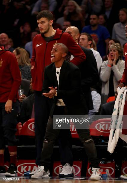 Isaiah Thomas of the Cleveland Cavaliers celebrates from the bench in the fourth quarter against the New York Knicks at Madison Square Garden on...