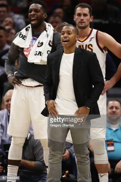 Isaiah Thomas of the Cleveland Cavaliers cheers on his teammates from the bench while playing the Milwaukee Bucks at Quicken Loans Arena on November...