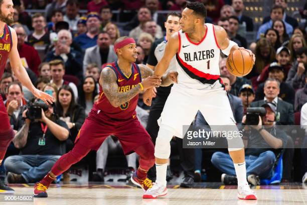 Isaiah Thomas of the Cleveland Cavaliers guards Evan Turner of the Portland Trail Blazers during the first half at Quicken Loans Arena on January 2...